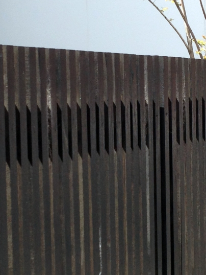 Vertical lines of a dark fence, image courtesy of p.ic - Photo Internet Collection - www.photoic.wordpress.com, photographer: Federico Viola